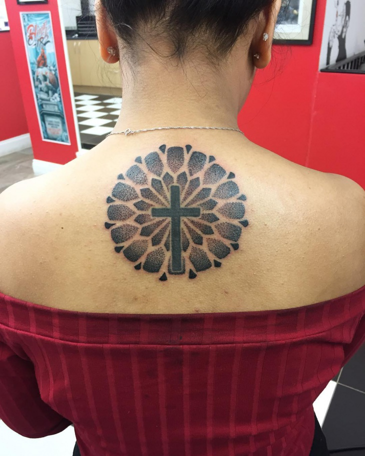 girl cross tattoo on back