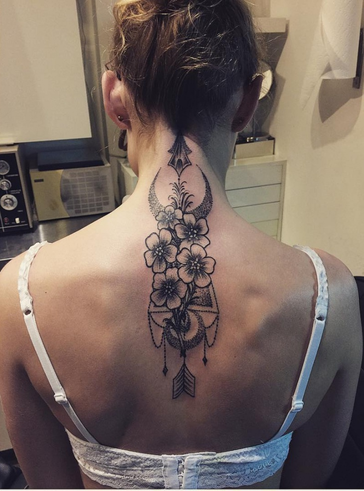 arrow tattoo on back neck