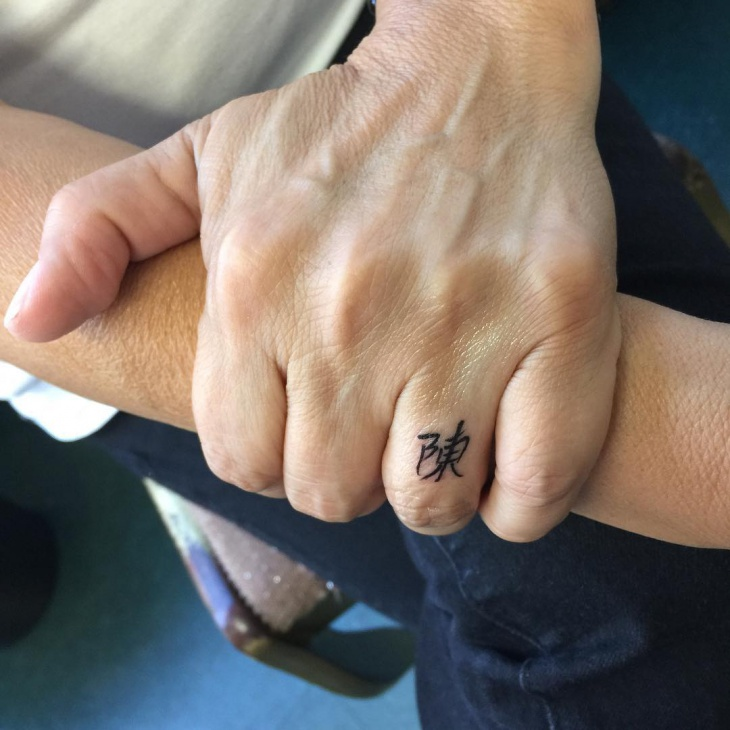 japanies ring finger tattoo