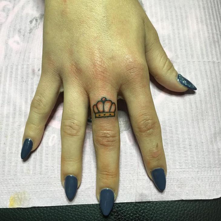 princess crown tattoo on finger