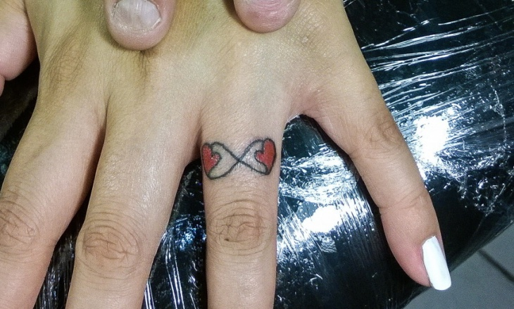 love infinity finger tattoo
