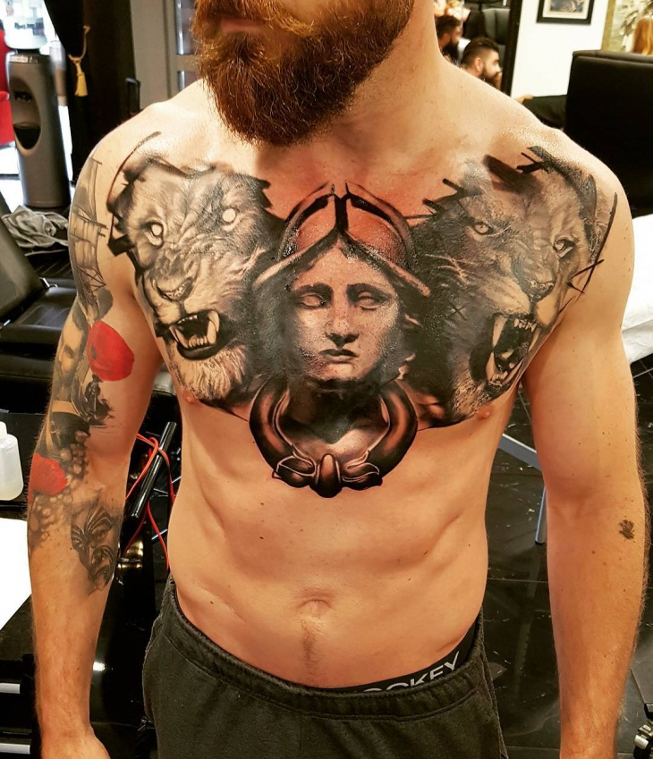 roaring lion chest tattoo