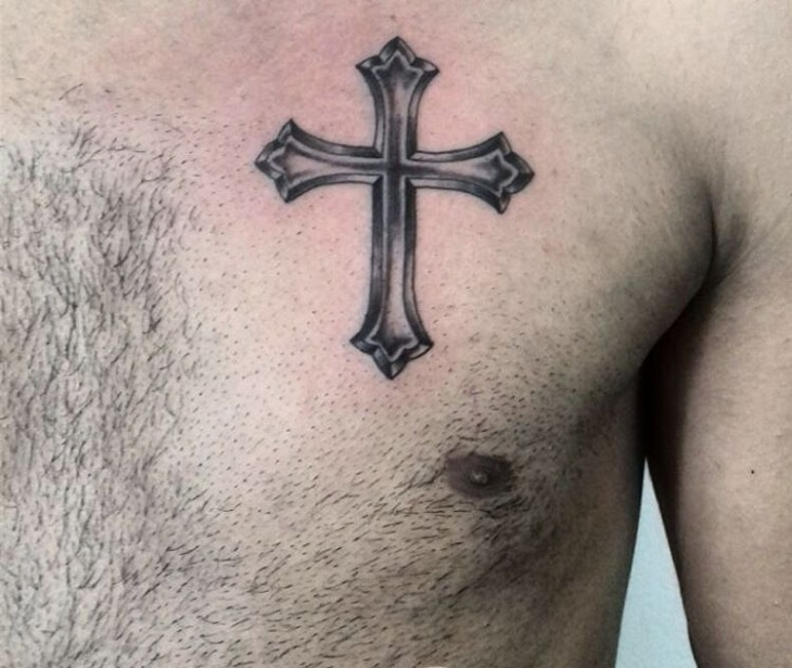 small cross chest tattoo