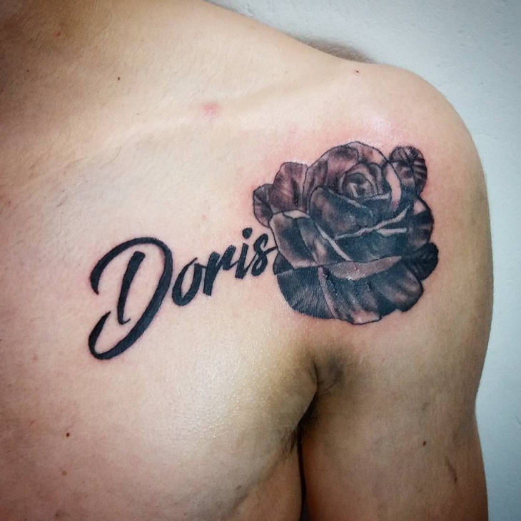 Name with Flower Chest Tattoo