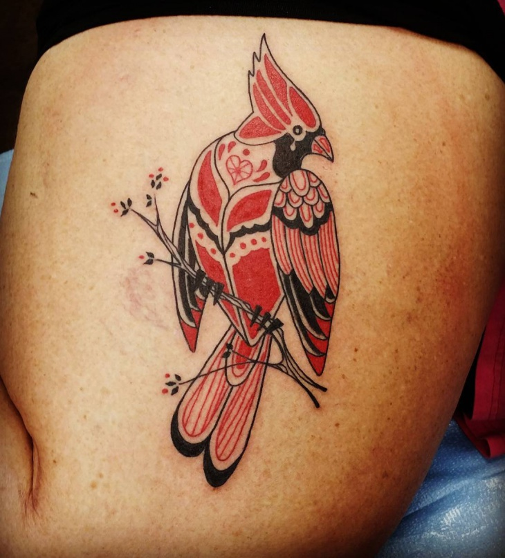 tribal bird tattoo on thigh