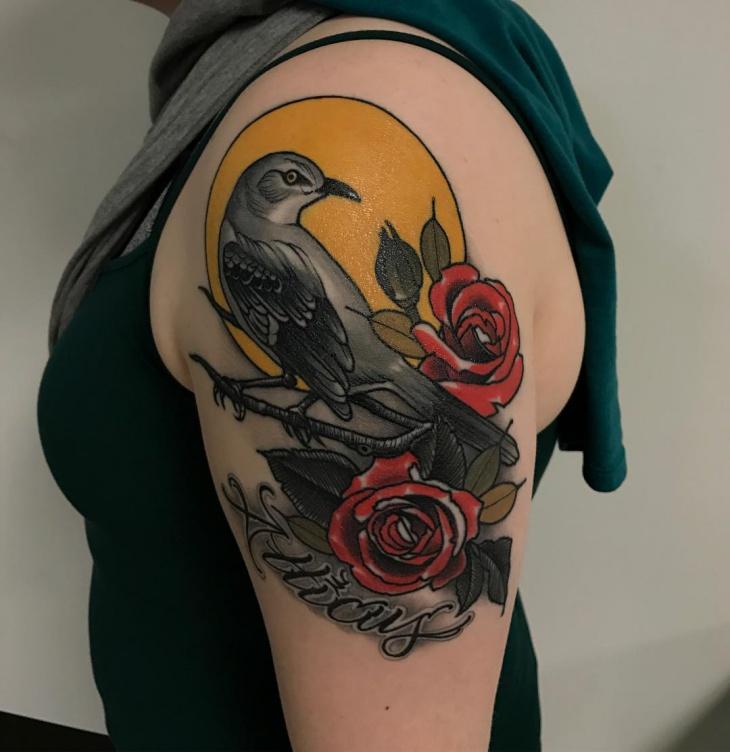flower and bird arm tattoo