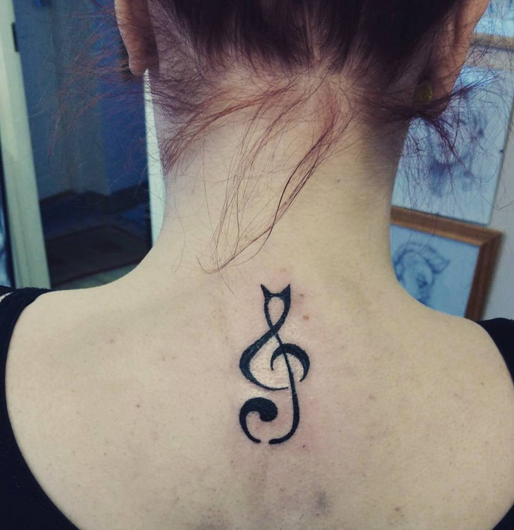 small music tattoo on back