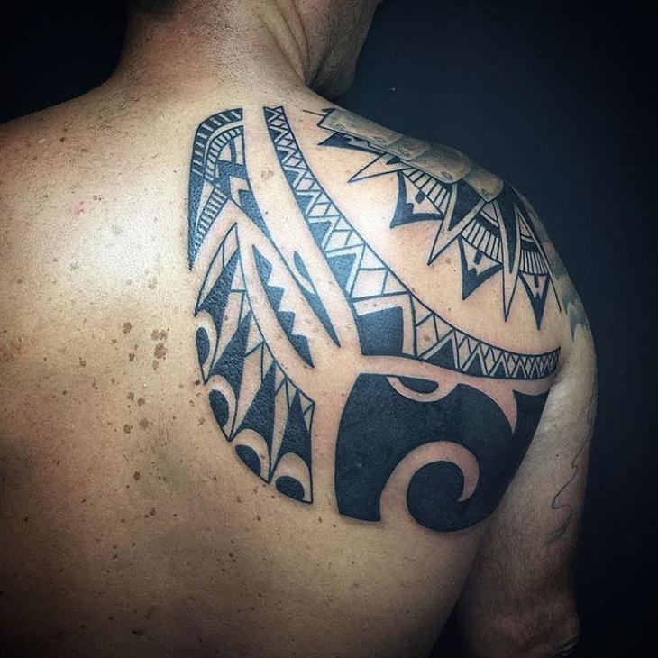 tribal half back tattoo design
