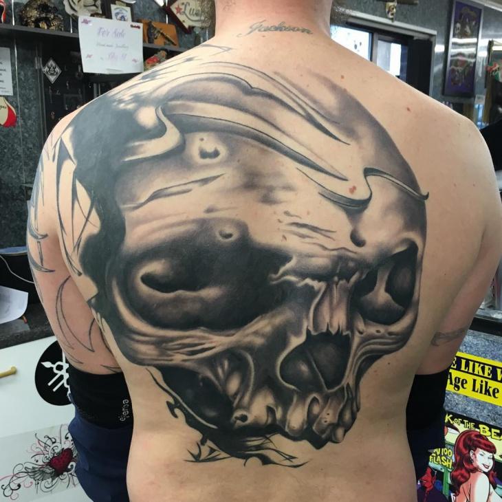 black skull back tattoo