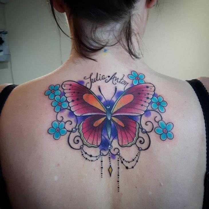 flower tattoo on upper back