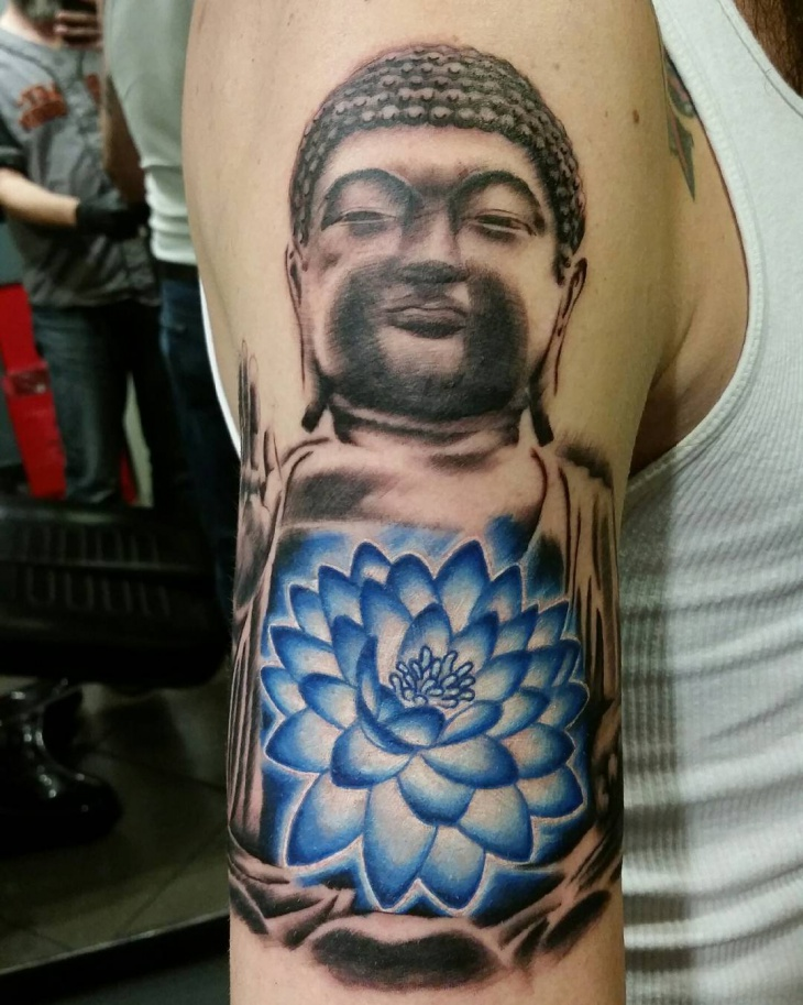 blue lotus flower tattoo on sleeve