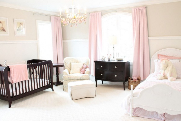 baby girl bedroom with chandelier