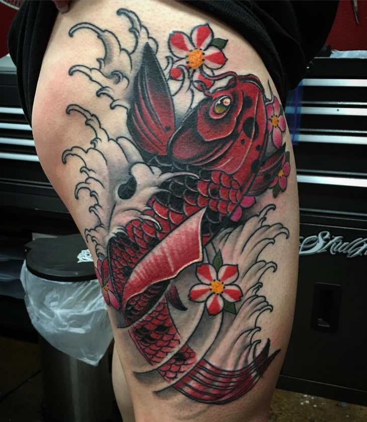colorful koi fish thigh tattoo
