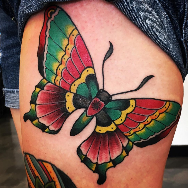 colorful butterfly thigh tattoo for women