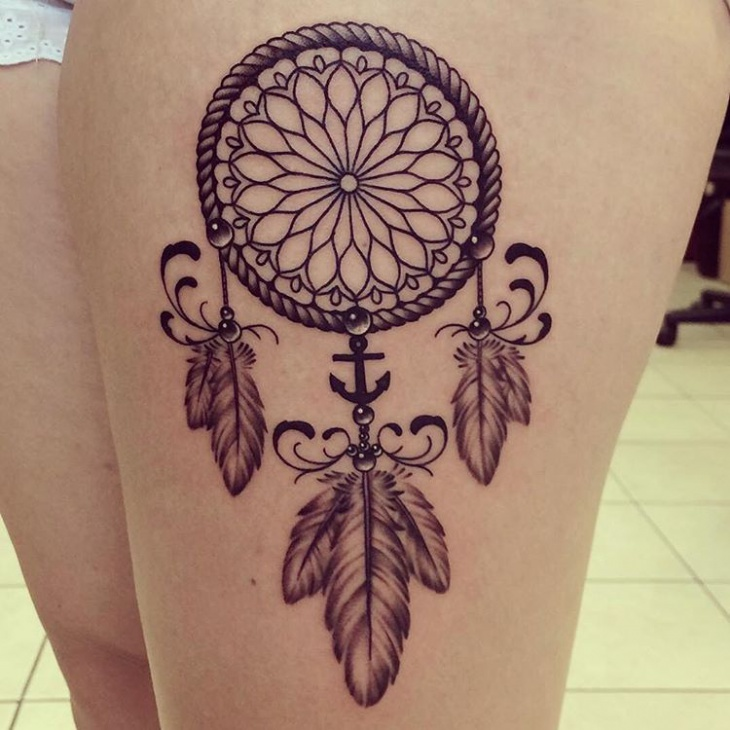 traditional dreamcatcher tattoo on thigh