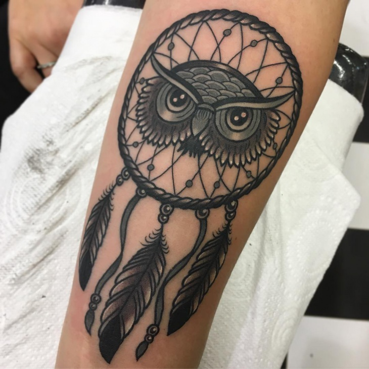 owl dreamcatcher tattoo on forearm