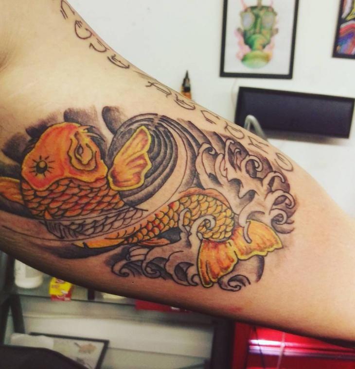 koi fish inner arm tattoo
