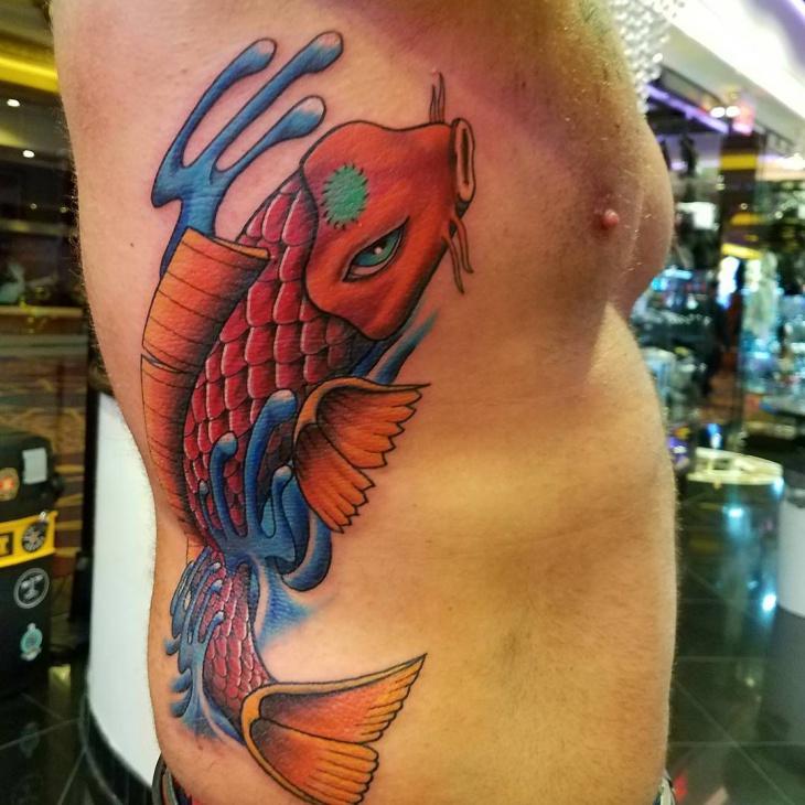 koi fish tattoo on side ribs