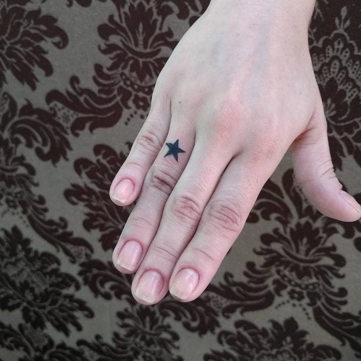 small star tattoo on finger