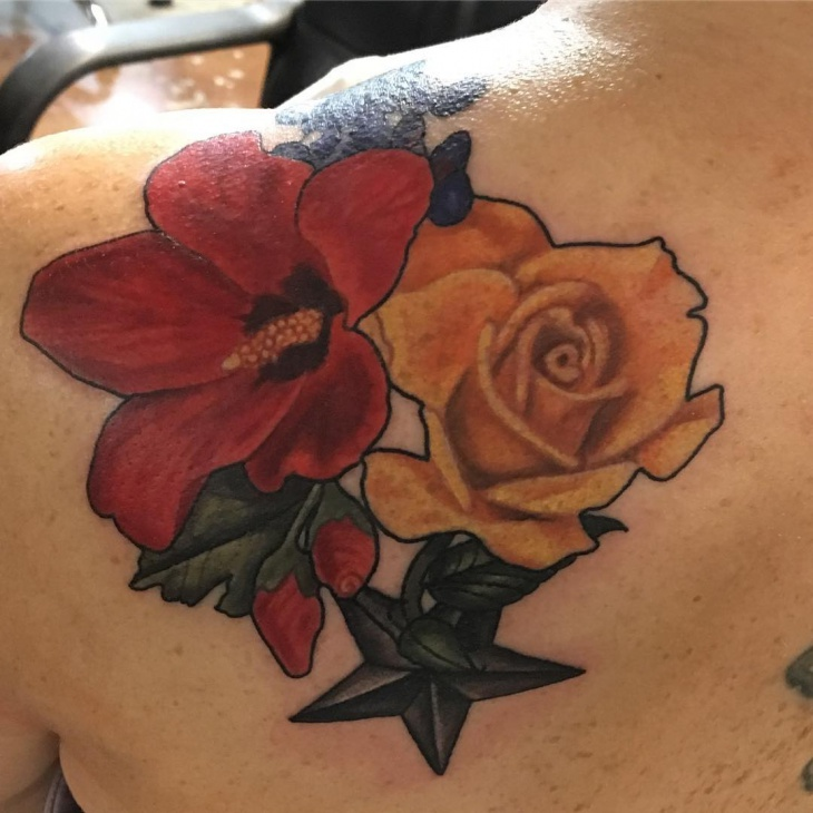 flower and star tattoo on shoulder