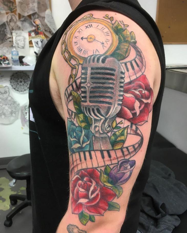 music instrument tattoo on sleeve