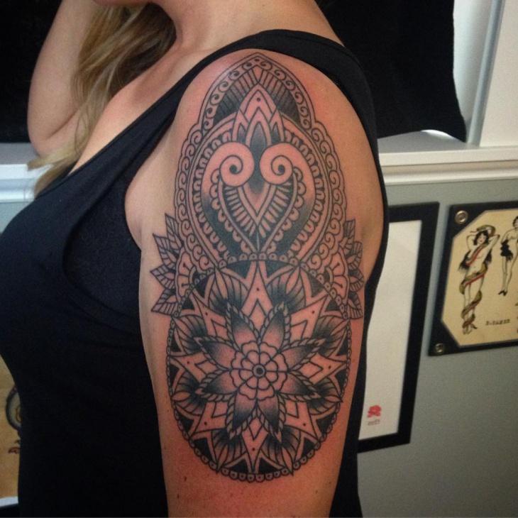mandala flower tattoo on sleeve