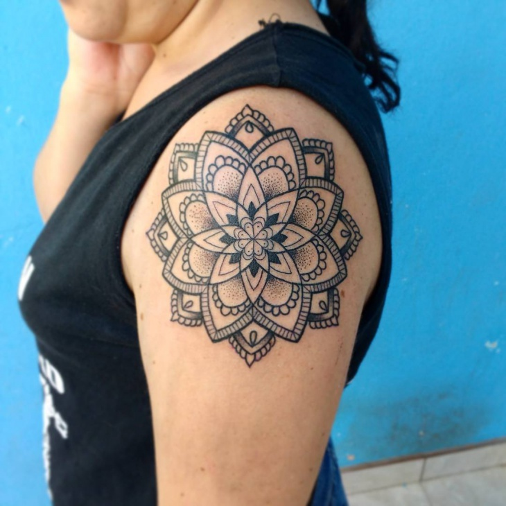 mandala above arm tattoo