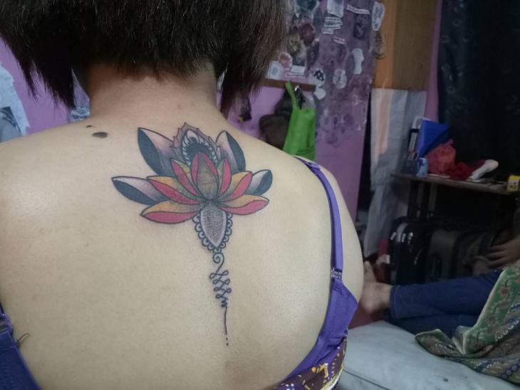 lotus mandala tattoo on back1