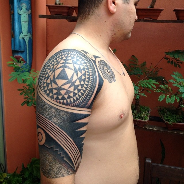 geometric tribal tattoo on sleeve
