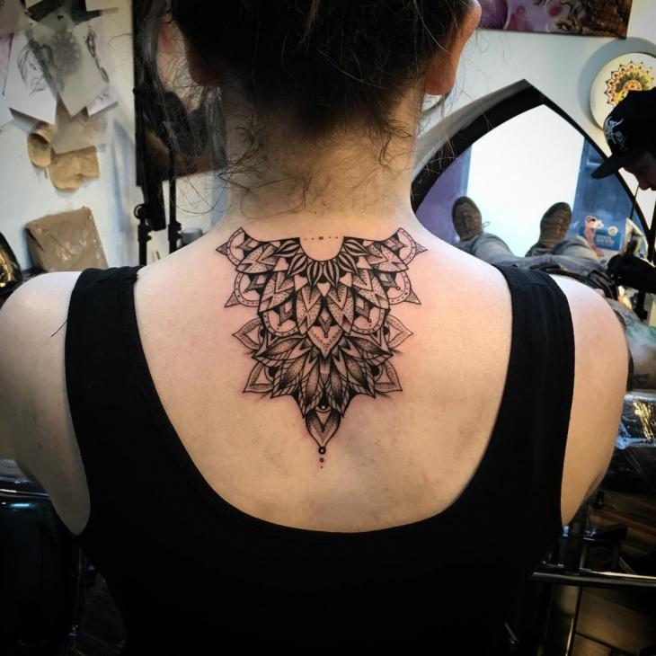 geometric mandala tattoo on back