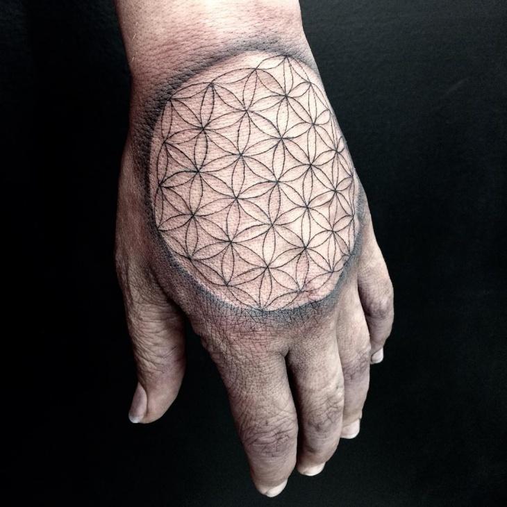geometric hand flower tattoo