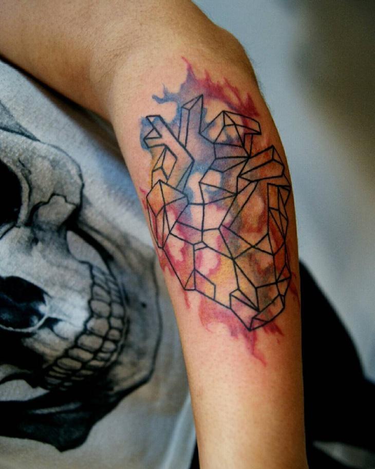 watercolor geometric tattoo on arm