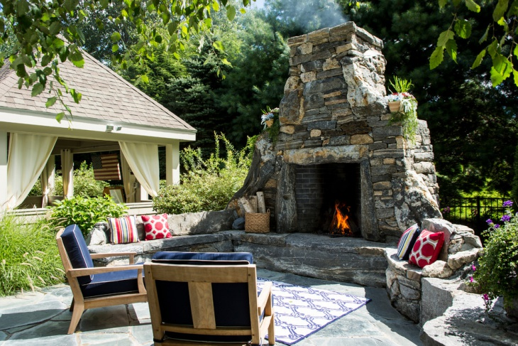 rustic outdoor stone fireplace