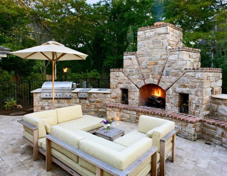 outdoor stone and brick fireplace
