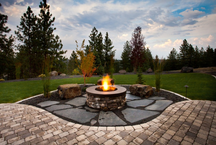 backyard round stone fireplace