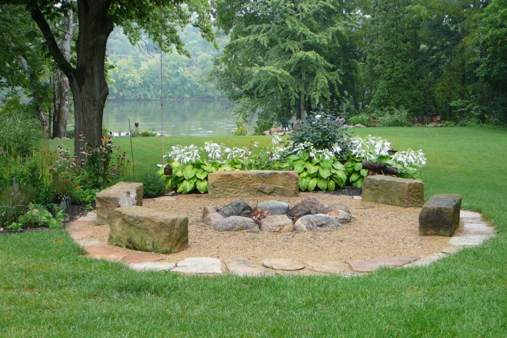 traditional backyard stone fireplace