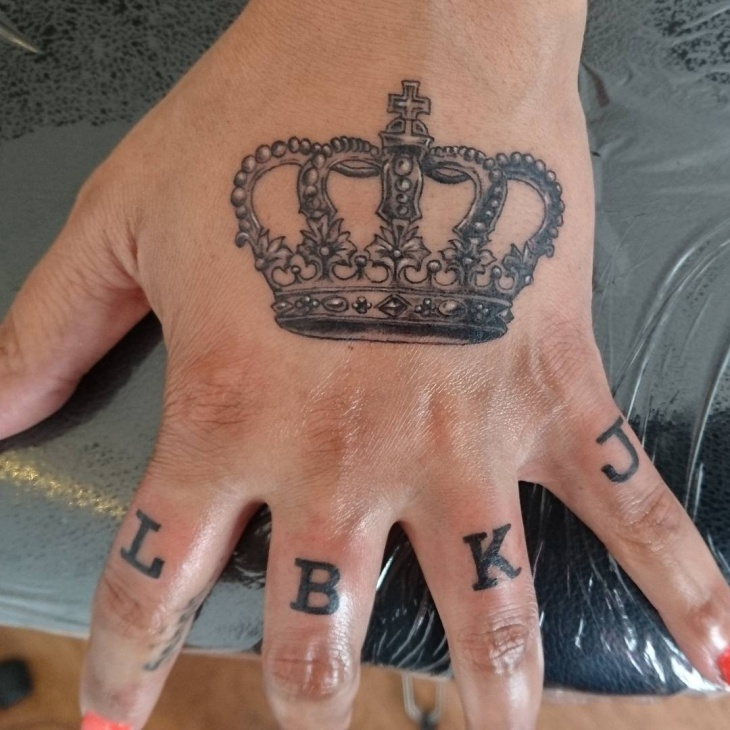 queen crown tattoo on hand