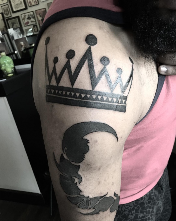 tribal crown tattoo on sleeve