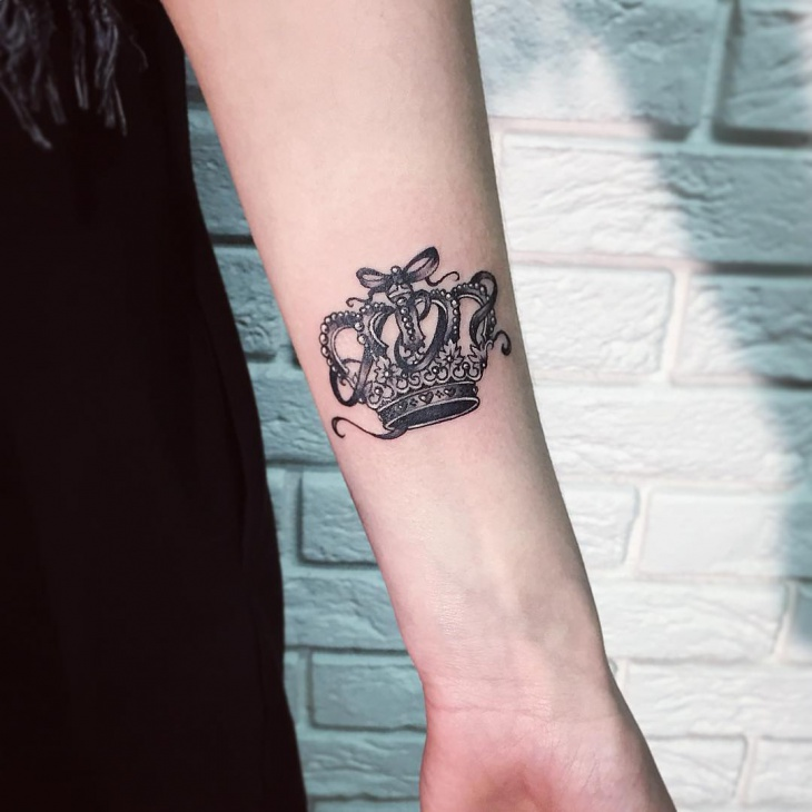 crown forearm tattoo