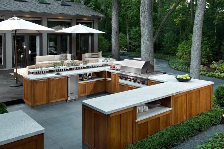 outdoor kitchen with wooden storage cabinets
