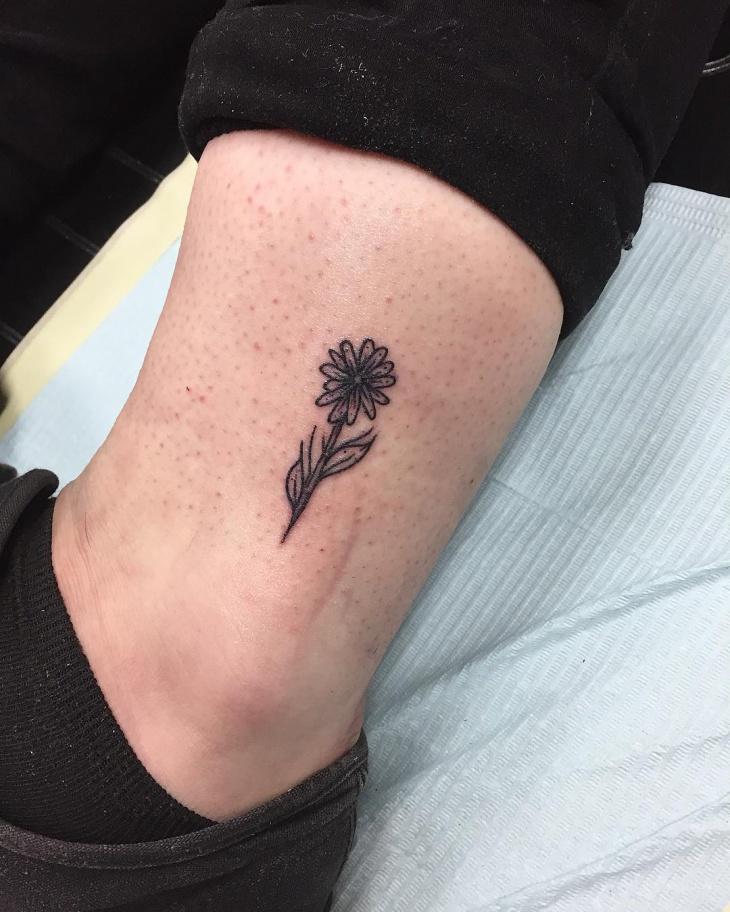 Small Sunflower Tattoo on Leg