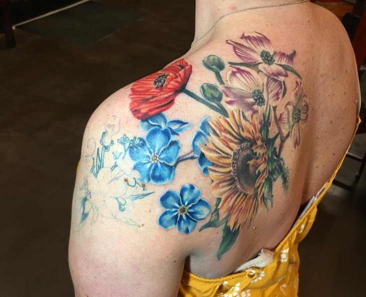 watercolor sunflower tattoo on shoulder