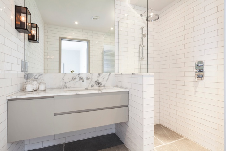 corner walk in shower with white tiles