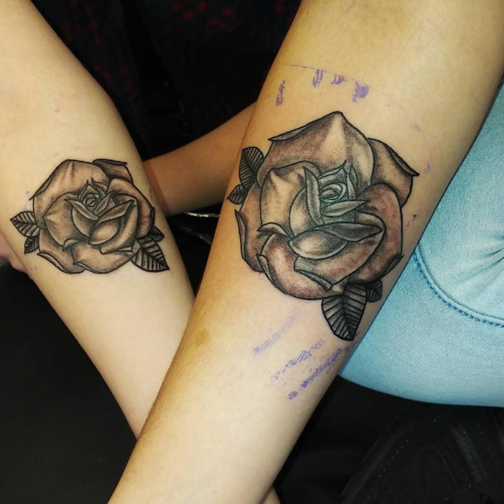 Matching Rose Tattoo on Forearm
