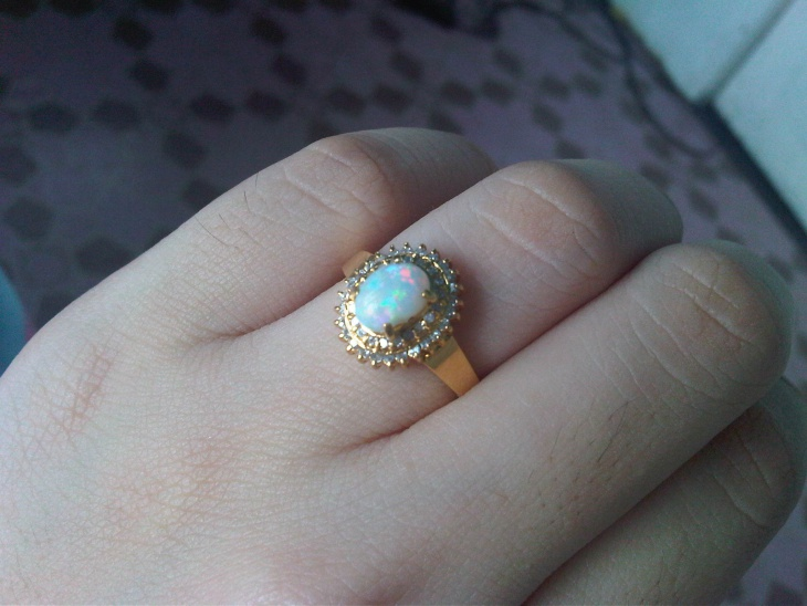 gold opal eagagement ring
