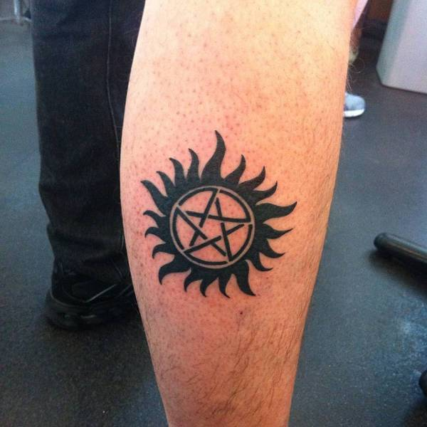 Tribal Sun Tattoo on Leg