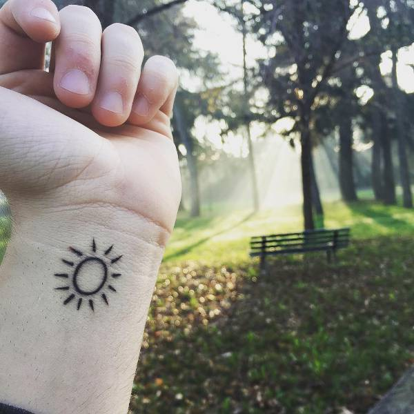 Small Sun Tattoo on Wrist