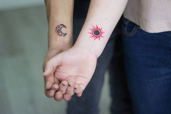 Sun Couple Tattoo on Wrist
