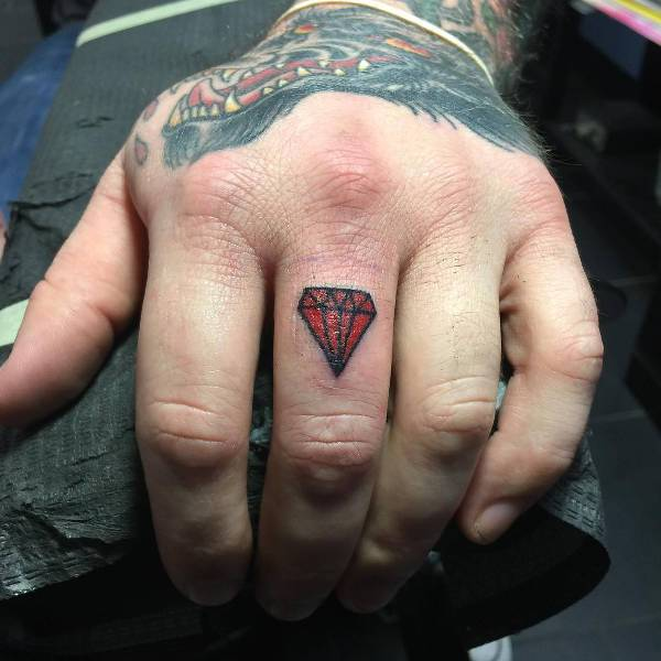 Red Diamond Finger Tattoo