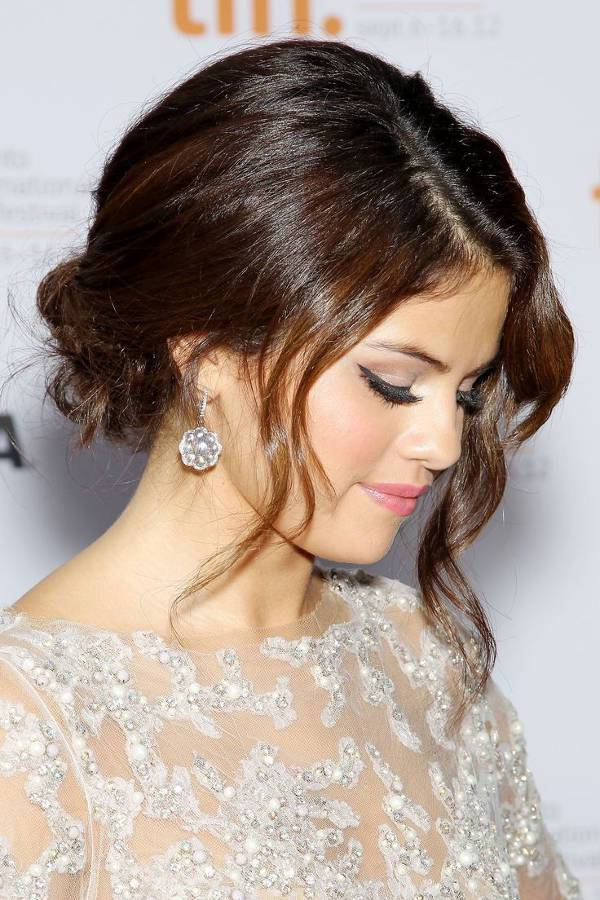Selena Gomez Messy Bun with Bangs Hairstyle